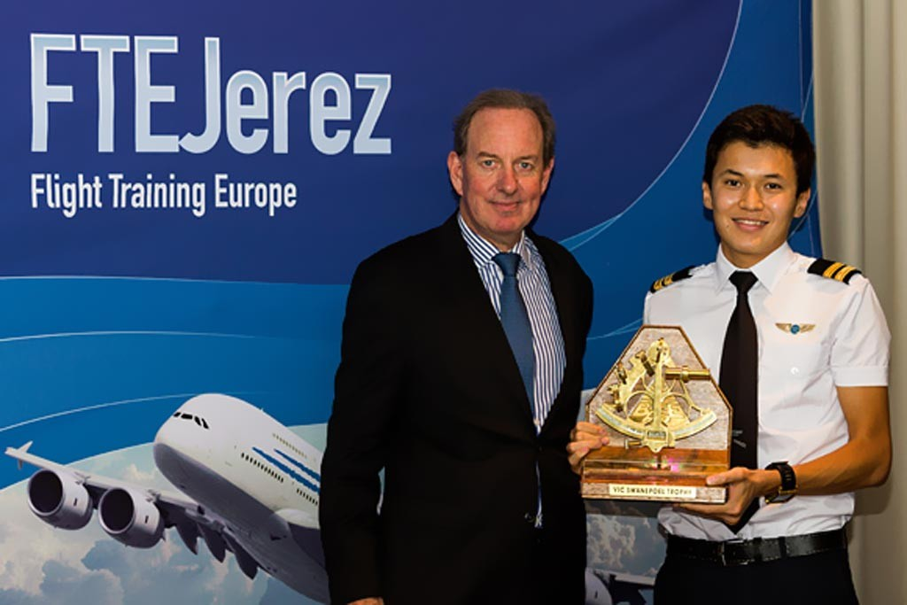 Altynbek Zeinelov receiving the Vic Swanepoel trophy from Mr. Peter Foster, President of Air Astana.